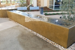 This stunning water feature was created using Bomanite integrally colored concrete that was installed with a smooth trowel finish to complement the tranquil and therapeutic design aesthetic.