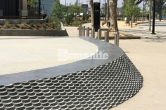 Bomel Construction Company used the Bomanite Alloy Exposed Aggregate System to create contrasting bands of decorative concrete at the LAFC Banc of California Stadium, incorporating clear glass aggregates and reflective mirror flakes to add intricate, eye-catching detail to the hardscape.