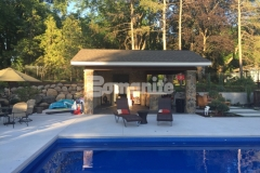 Bomanite Revealed Exposed Aggregate decorative concrete was installed here to create this stunning pool decking and this system will provide increased surface and slip resistance while reducing heat island effect, making the pool deck walkable and not hot to the touch.