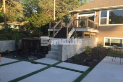 Concrete Arts utilized the Bomanite Antico process to create a wall cap to top these cast-in-place concrete retaining walls and the travertine-like finish is a perfect complement to the old-world charm design aesthetic in this backyard resort space.