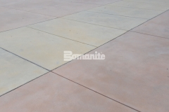 Sandscape Texture by Bomanite was installed here in three different colors to create a beautiful decorative concrete courtyard with a unified design aesthetic that perfectly connects multiple gathering spaces.