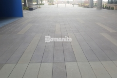 Featured here is Bomanite Sandscape Texture decorative concrete that was stained with Cobblestone Gray, Nickel Gray, and Natural Gray Bomanite Con-Colors to add a modern aesthetic to the hardscape surface through color, pattern, and texture.