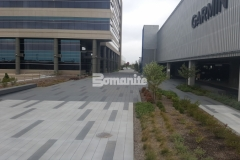 Bomanite Sandscape Texture decorative concrete was installed here and stained with gradients of gray Bomanite Con-Color, adding a modern design feel that draws attention to the perfectly executed joint layout on the hardscape surface.