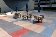 Sandscape Texture decorative concrete by Bomanite was installed here and stained to create a distinctive design by using both vibrant and subtle shades of Bomanite Con-Color to form a unique pattern that is visually interesting while maintaining a cohesive design feel.