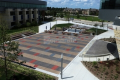 This stunning decorative concrete features Bomanite Sandscape Texture that was installed with a detailed stain pattern that adds visual appeal to the hardscape while complementing the surrounding architecture and creating visual continuity throughout the space.