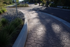Belarde Company installed this gorgeous decorative concrete hardscape utilizing Bomanite Bomacron Creek Stone stamped concrete that was custom colored to complement the natural surroundings and adjacent design at the Washington NE 36th Street Bridge Roundabout.