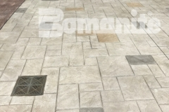 Bomanite imprinted concrete was installed here to create a decorative hardscape surface, using the Bomacron Ashlar Slate pattern with an integrally colored gray border to add a unique and beautiful design touch to this outdoor space.