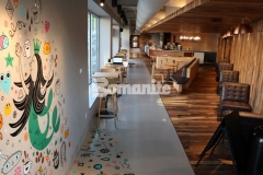 Musselman & Hall Contractors installed this stunning Bomanite Modena SL decorative concrete overlay and coordinated with a Starbucks artist who utilized a portion of the floor as a canvas to paint this fun, colorful mural and the interplay of colors in combination with the beautiful, polished flooring showcases the flexibility and decorative nature of Bomanite architectural concrete.