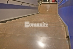 Featured here is Bomanite Patene Teres custom polished concrete that was colored with a custom brown dye to create a durable and decorative flooring surface with a warm, welcoming feel.