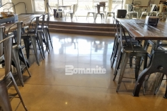 The Patene Teres Custom Polishing System by Bomanite was used here to create a stunning decorative concrete flooring surface that is highly durable and will hold up to the heavy foot traffic throughout this church café.