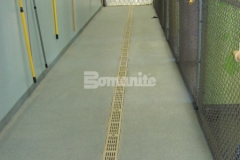 The Bomanite Broadcast Aggregate System is featured here, utilizing non-skid aggregates to create a highly durable, low maintenance flooring surface that is easy to clean and maintain, perfect for this dog kennel environment.