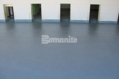 The Bomanite Broadcast Aggregate System is a multi-layered architectural and protective flooring system with a non-skid aggregate surface, using a multitude of surface seeded fine aggregates to create a highly durable, low maintenance surface.