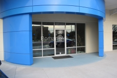 Texas Bomanite using Bomanite Toppings Systems with Broadcast Aggregate decorative concrete at First Texas Honda in Austin, Texas.