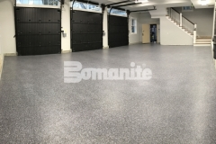 The Bomanite Broadcast Flake Toppings System was installed here as the solution to a badly poured concrete garage foundation and will provide a protective flooring surface that will stand up to long term wear and tear.