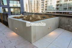 Bomanite Micro-Top ST is a specialized decorative concrete option that can cover virtually any surface and was applied here as an overlay to create planter boxes that are durable and versatile enough to withstand weather while providing a sandscape texture with beautiful coloration.