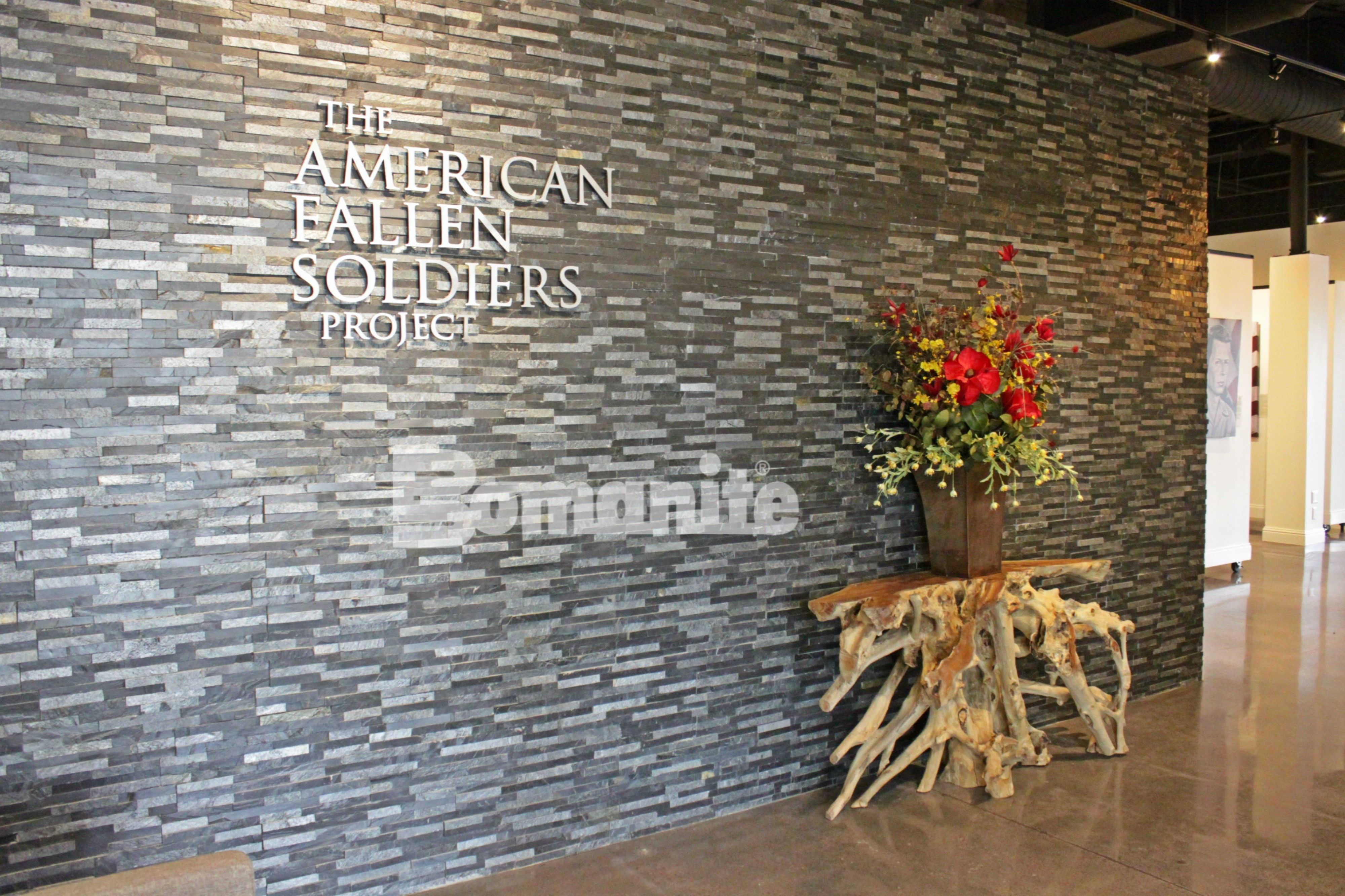 The American Fallen Soldiers Project Gallery, in Addison TX, featuring Bomanite Custom Polishing System using Bomanite Patene Teres decorative concrete flooring.