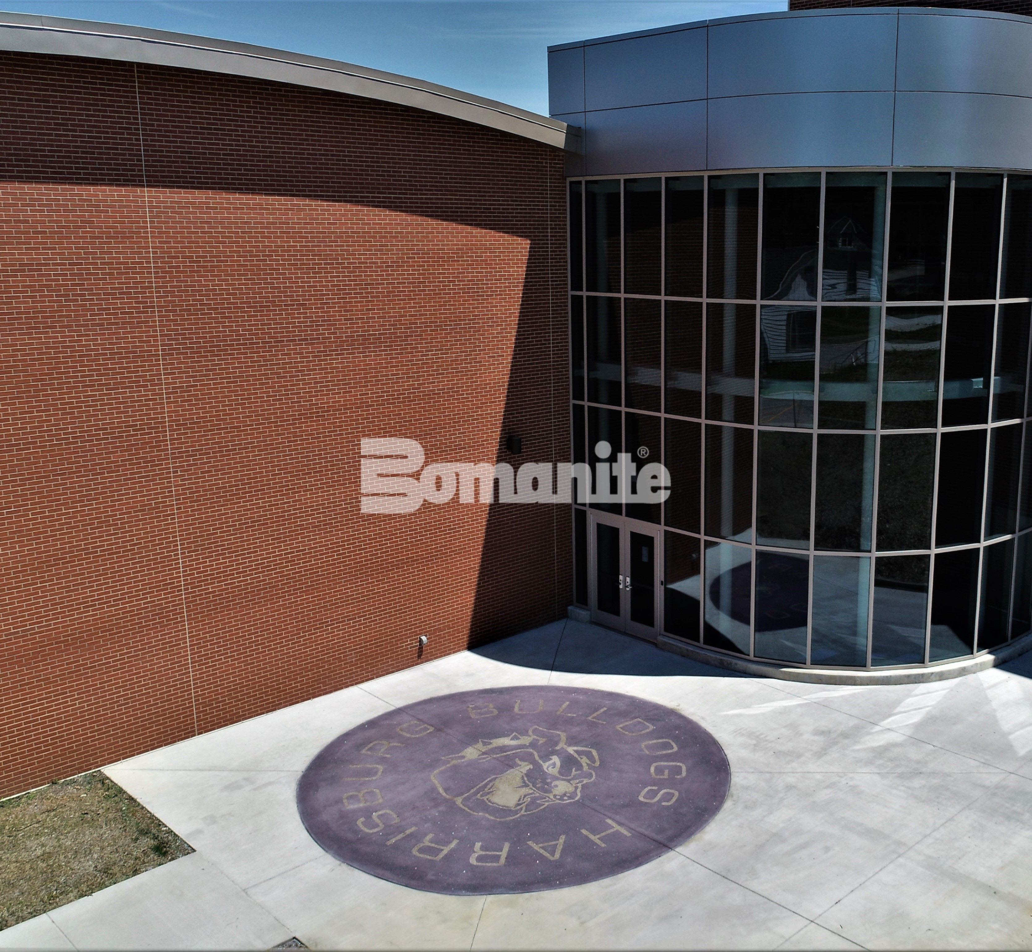 Harrisburg High School Logo using Bomanite Exposed Aggregate Decorative Concrete with Bomanite Alloy in Harrisburg, IL.