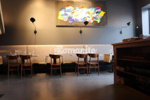 Modern Art and Bomanite Toppings Systems using Bomanite Micro Top decorative concrete flooring enhances the sophitication of Elmwood Restaurant in Maplewood, MO, installed by Bomanite Licensee Musselman and Hall.