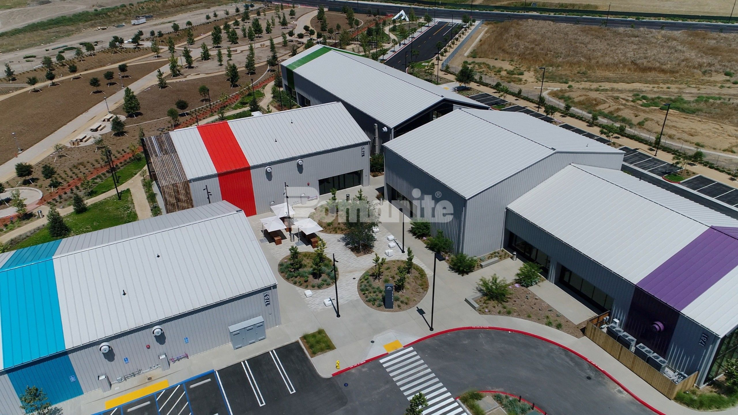 Flight At Tustin Legacy in Tustin, CA, features decorative concrete landscapes of Bomanite Revealed Exposed Aggregate Systems installed by Bomel Construction.